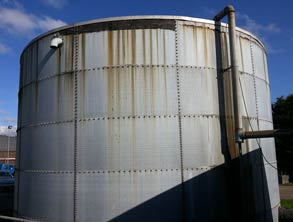 Large sprinkler tank with corrosion at water line