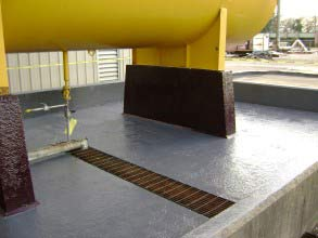 Chemical resistant coating applied to chemical bund